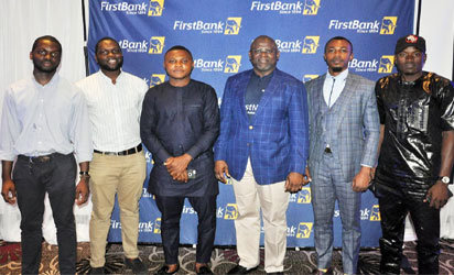 Adesola Adeduntan, Managing Director/Chief Executive Officer, First Bank of Nigeria Limited (third right) flanked by some FirstBank customers, Ayo Daniyan (left), Mayowa Daniyan (second left), Onyejekwe Nnaemeka (third left), Nicholas Okonkwo (second right) and Safiyanu Faisa (right) at the FirstBank Voice of Customer held with the Retail Youth segment in Lagos recently.