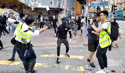 Hong Kong police officer shoots protester at point-blank range while activists set another man on fire