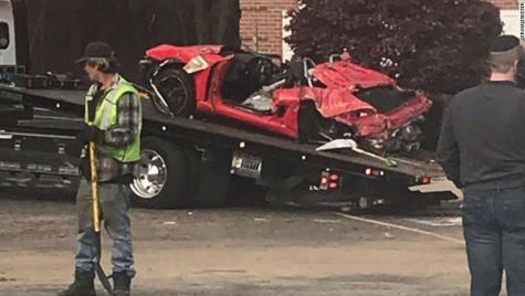 Speeding Porsche crashes into second storey after losing control