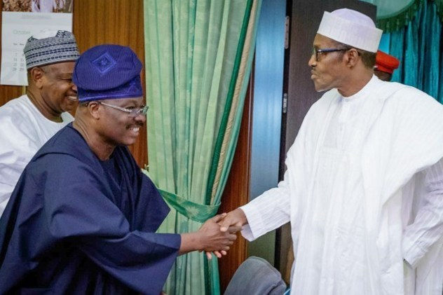 Former Governor of Oyo State, Sen. Abiola Ajimobi (Left) shaking President Muhammadu Buhari (Right)