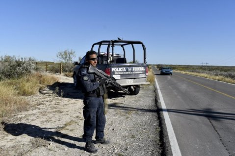 Police guard the highway leading to ViIlla Union, Mexico
