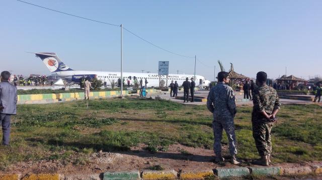 Iranian passenger plane slides off runway into highway