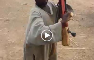 7-year-old boy who has been to Sambisa demonstrates gun handling, shooting strategies