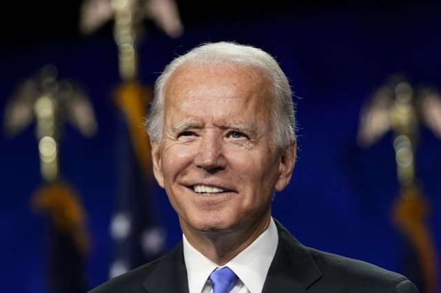 Biden, aiming at Trump, says he won't use military as 'prop'