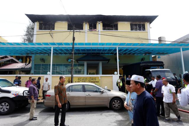 Malaysian court jails teenager for killing 23 people in school fire