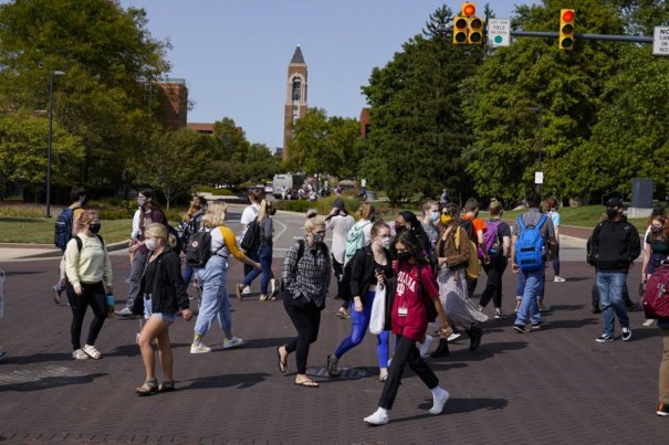 Coronavirus infection rates soar in US college towns as students return