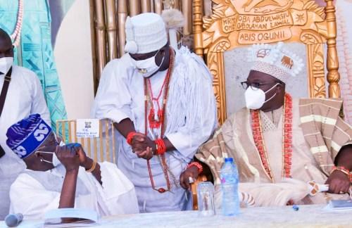 Divided views as Tinubu sits to greet Ooni of Ife at Oniru's coronation