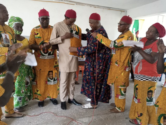 Justice Peter Umeadi (third from right) decorating Chief Frank Oraeki into APGA at a ceremony in Nri, Anaocha LGA, Anambra State
