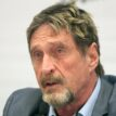 Software icon, McAfee, charged in cryptocurrency scam
