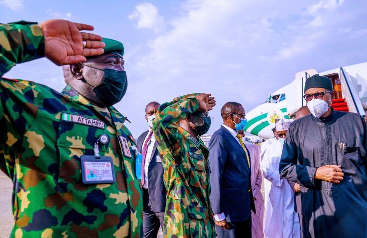 PHOTOS: Buhari returns to Nigeria from UK medical trip