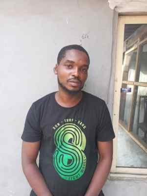 A man arrested for allegedly driving against traffic in Lagos