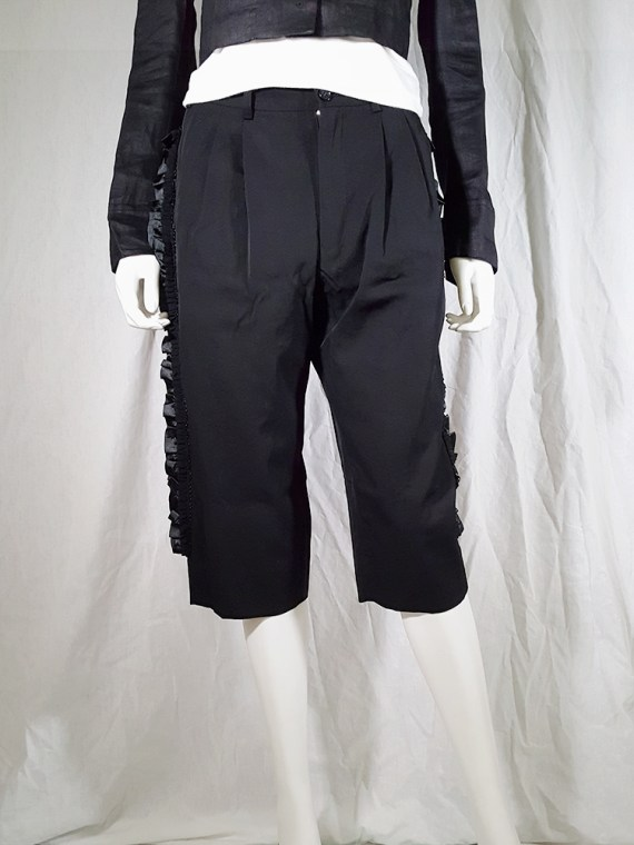 Comme des Garçons black trousers with ruffles back panels — fall 2008