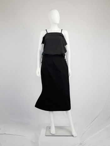 Yohji Yamamoto black structured skirt with sideways curve.