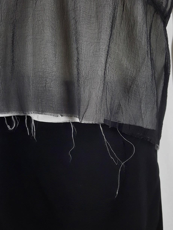 Maison Martin Margiela black tube top with white lining and frayed hems — fall 2004