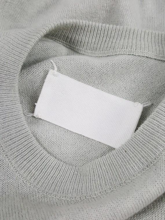 Maison Martin Margiela sage green sleeveless jumper worn sideways — spring 2005
