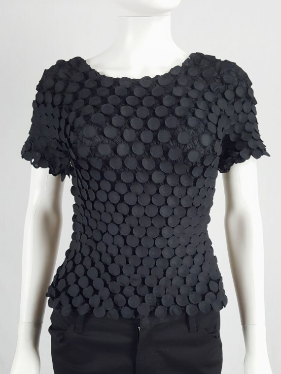 Issey Miyake black t-shirt with the fabric manipulated into 3D circles