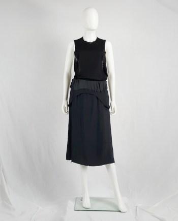 Maison Martin Margiela black dress worn as a skirt — spring 2003