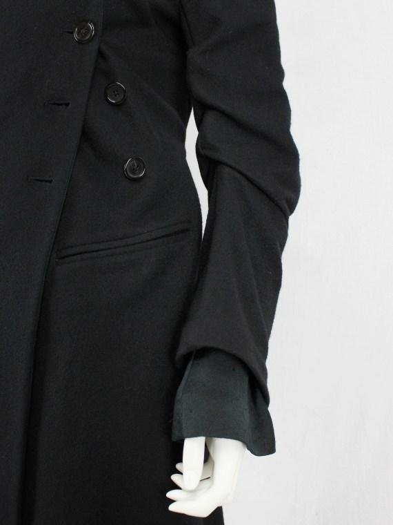 Ann Demeulemeester black long coat with asymmetric button closure