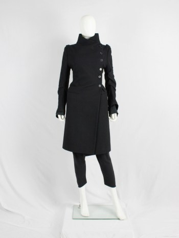 Ann Demeulemeester black long coat with asymmetric button closure