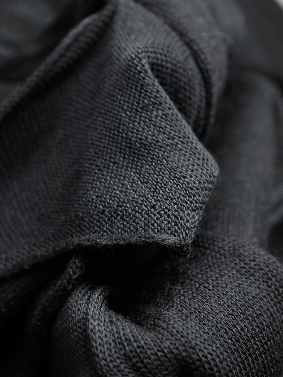Comme des Garçons black knit top with long drooping strips — spring 2015