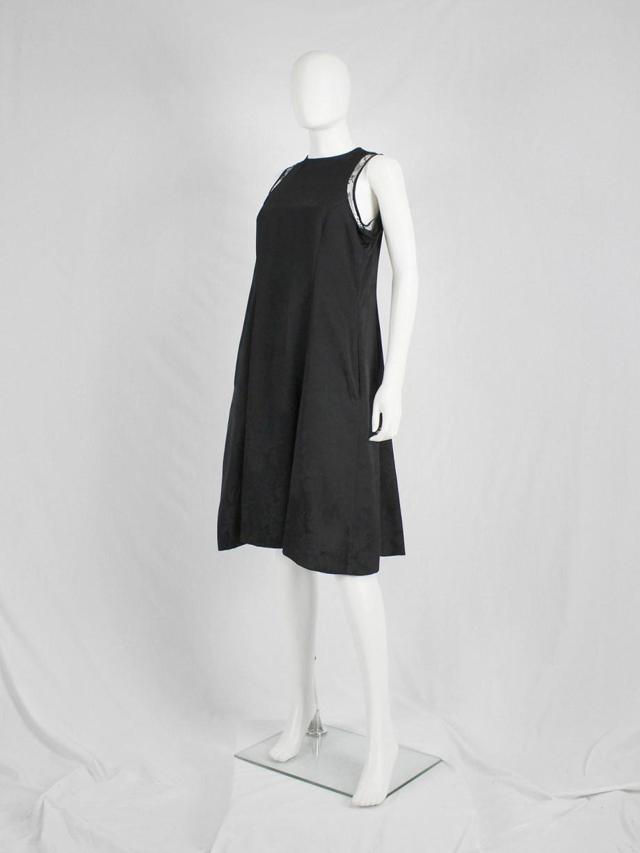 Noir Kei Ninomiya black floral brocade dress with lace trims — fall 2017