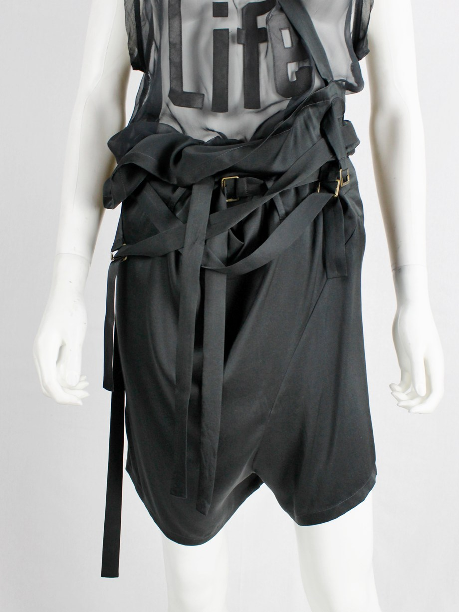 Ann Demeulemeester black shorts with suspenders and multiple front belt straps — spring 2003