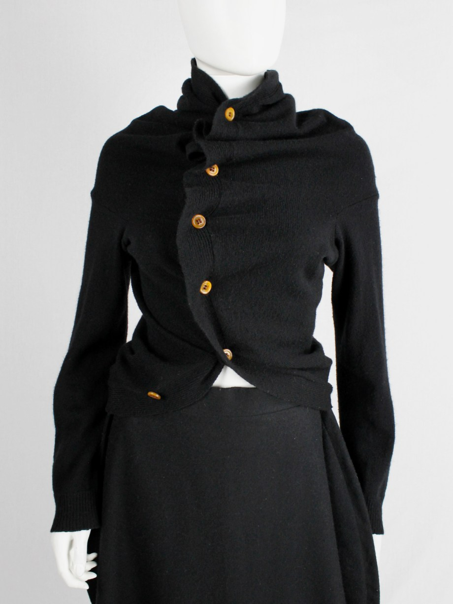 Comme des Garçons black circular cardigan with orange buttons and cutaway front — fall 2002