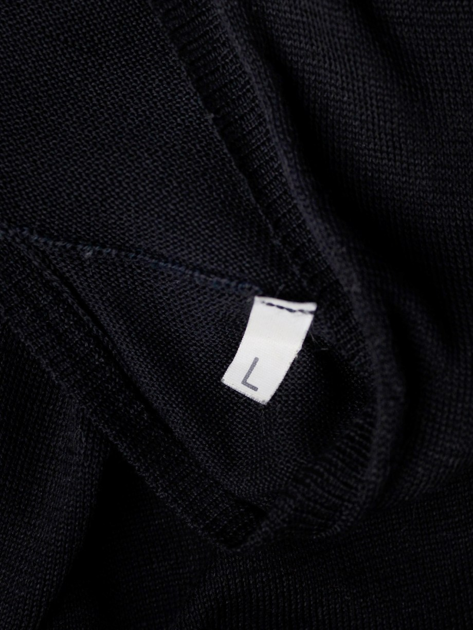 Maison Martin Margiela black t-shirt with cut open sleeves and hanging loose threads — spring 2003