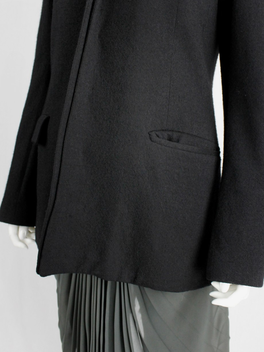 A.F. Vandevorst black wool coat with forward closing front and boning — fall 2000