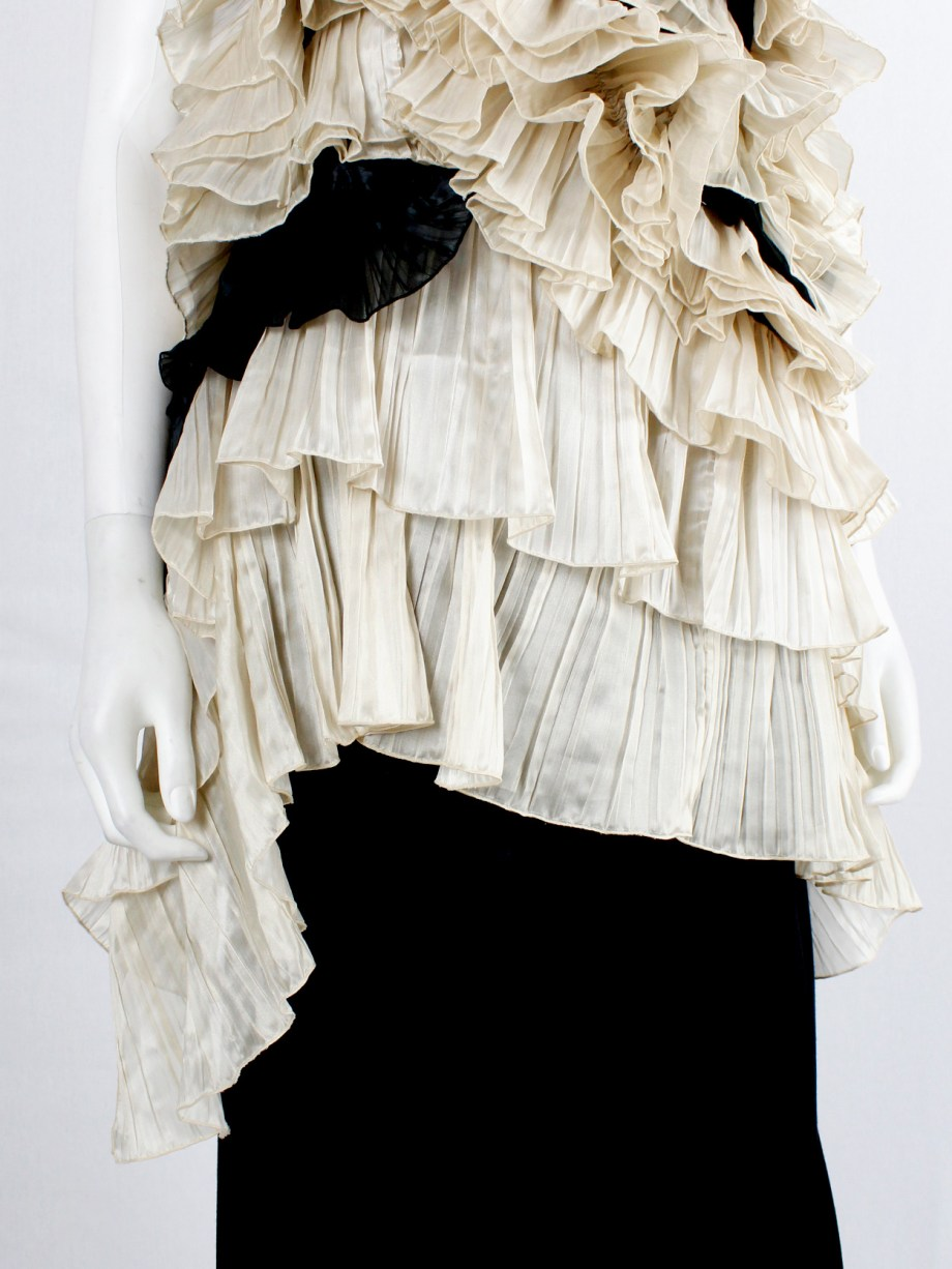 Dries Van Noten black top with many layers of sheer beige frills — spring 2014