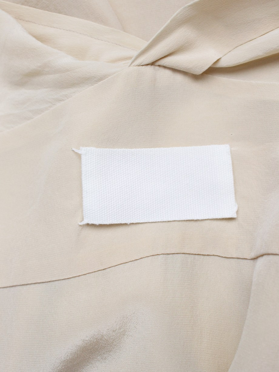 Maison Martin Margiela beige shirt that fully buttons up to the back — fall 2010