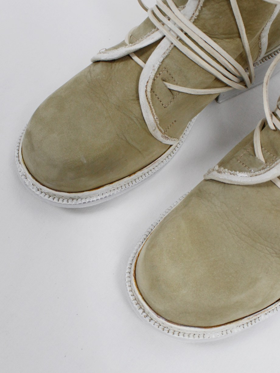 Dirk Bikkembergs beige cut out boots with white trim and laces through the soles — early 90's