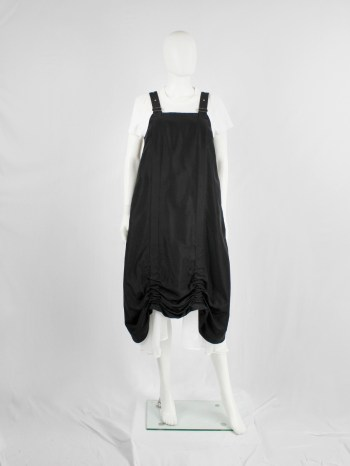 Noir Kei Ninomiya black salopette dress with belt straps and scrunched hem — spring 2019