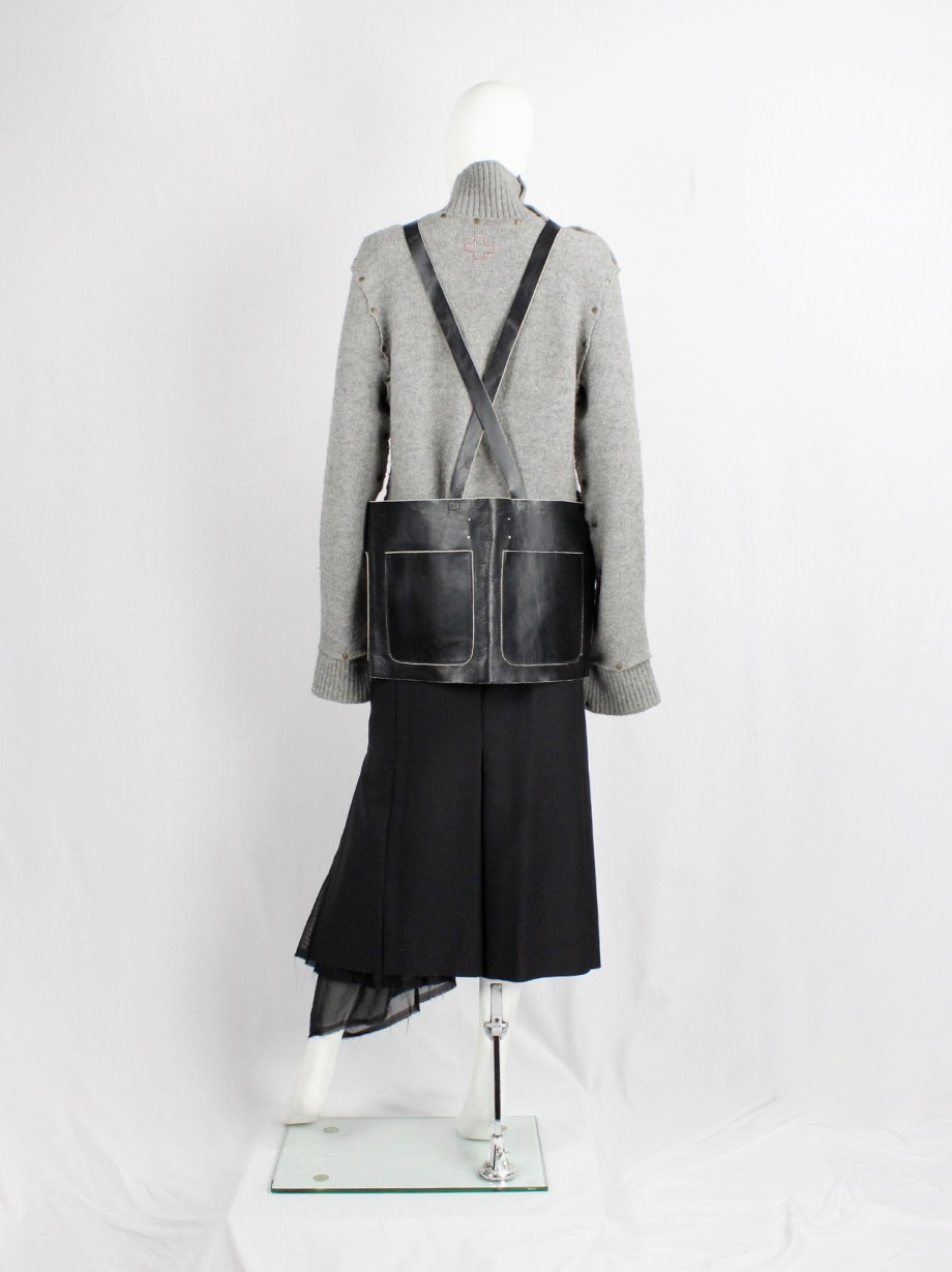 Maison Martin Margiela black leather apron with four pockets and crossed straps — fall 1998