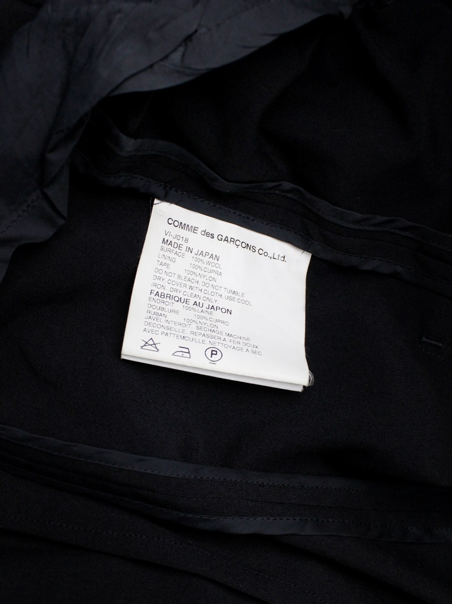Junya Watanabe black parachute jacket with harness straps and open back — spring 2003