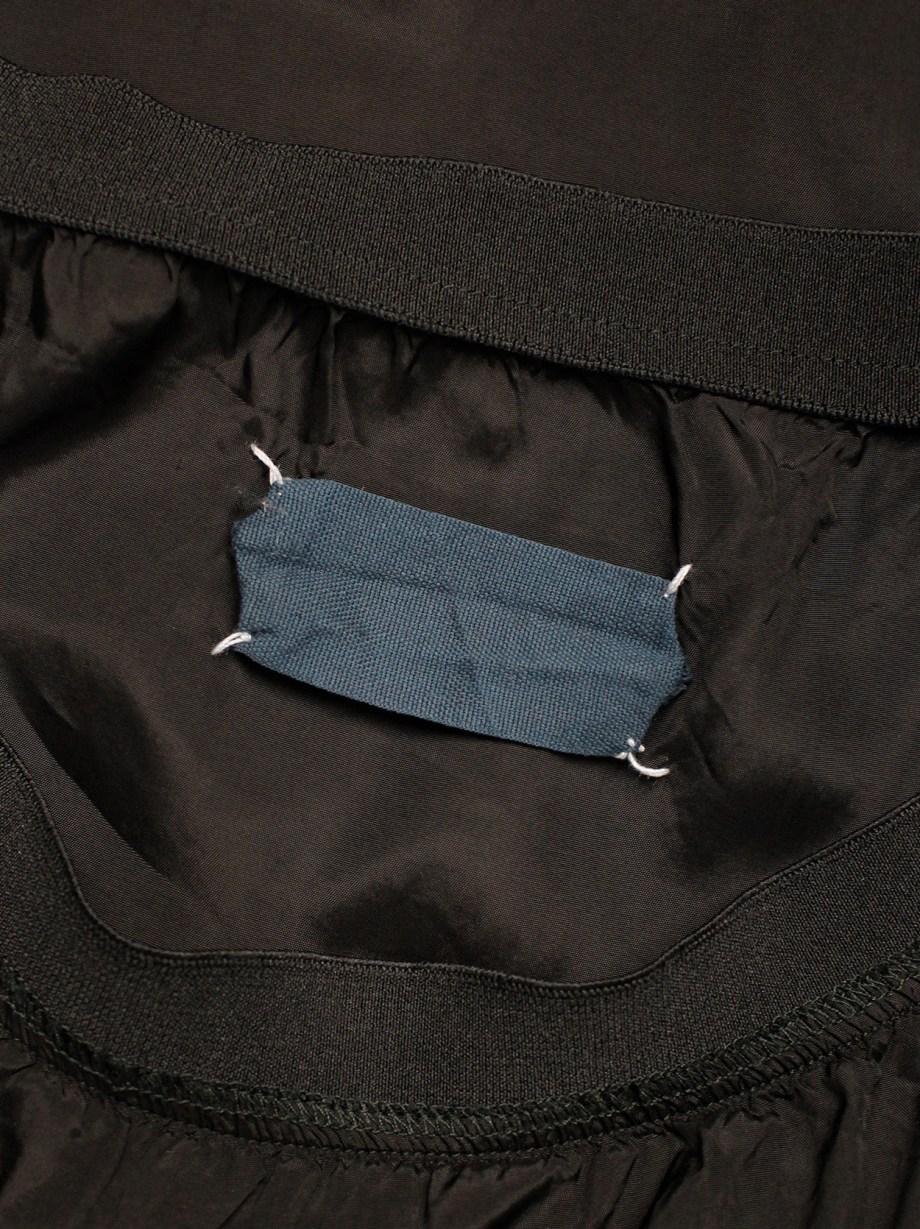 Maison Martin Margiela black skirt in shiny lining fabric — fall 1995
