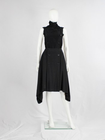 Ann Demeulemeester black skirt with buttons and curved hem — fall 2014