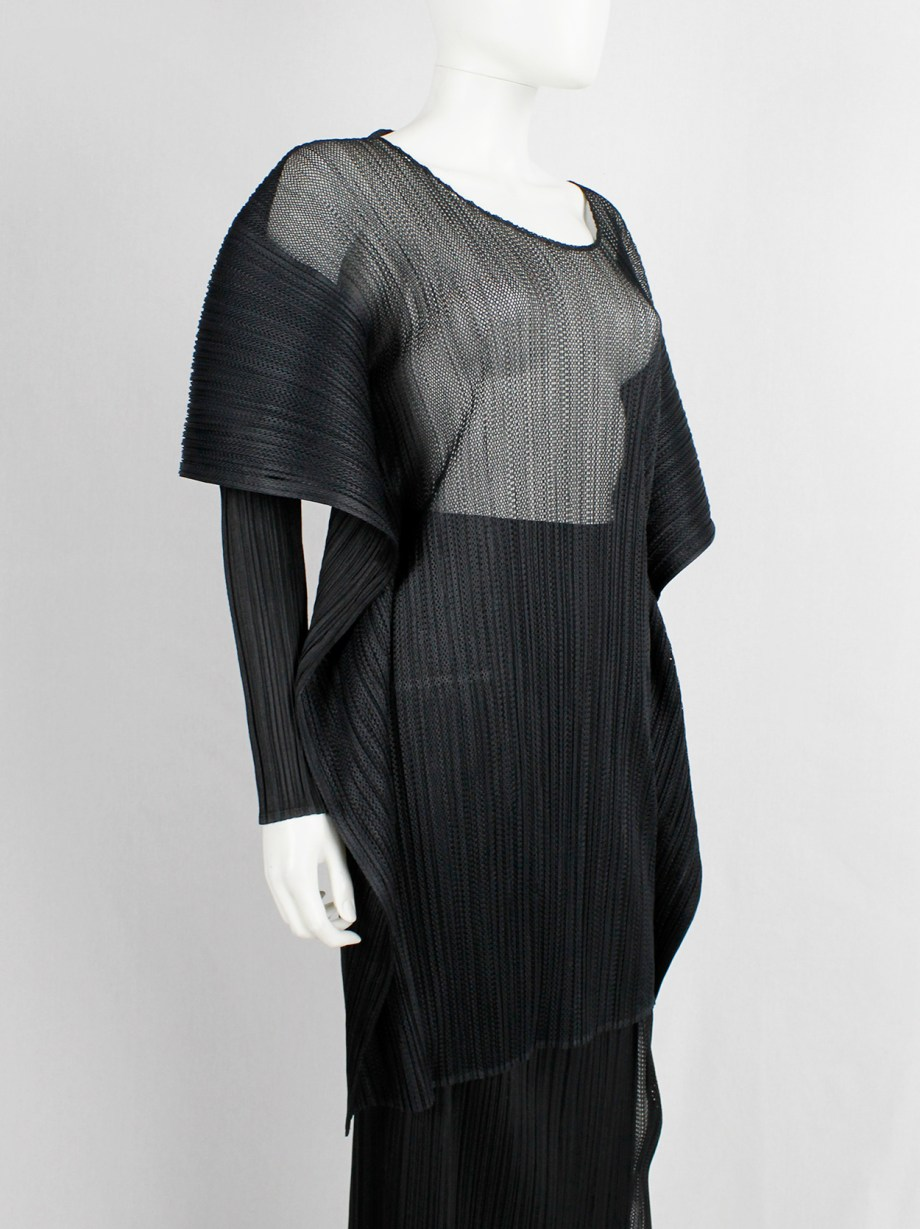 Issey Miyake Pleats Please black square jumper buttoned into a folded cardigan