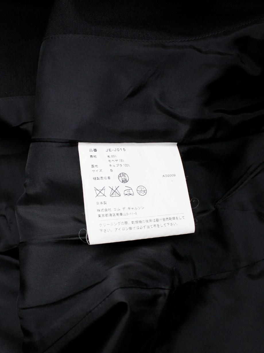 Junya Watanabe black tulip-shaped blazer with curved back opening — spring 2010
