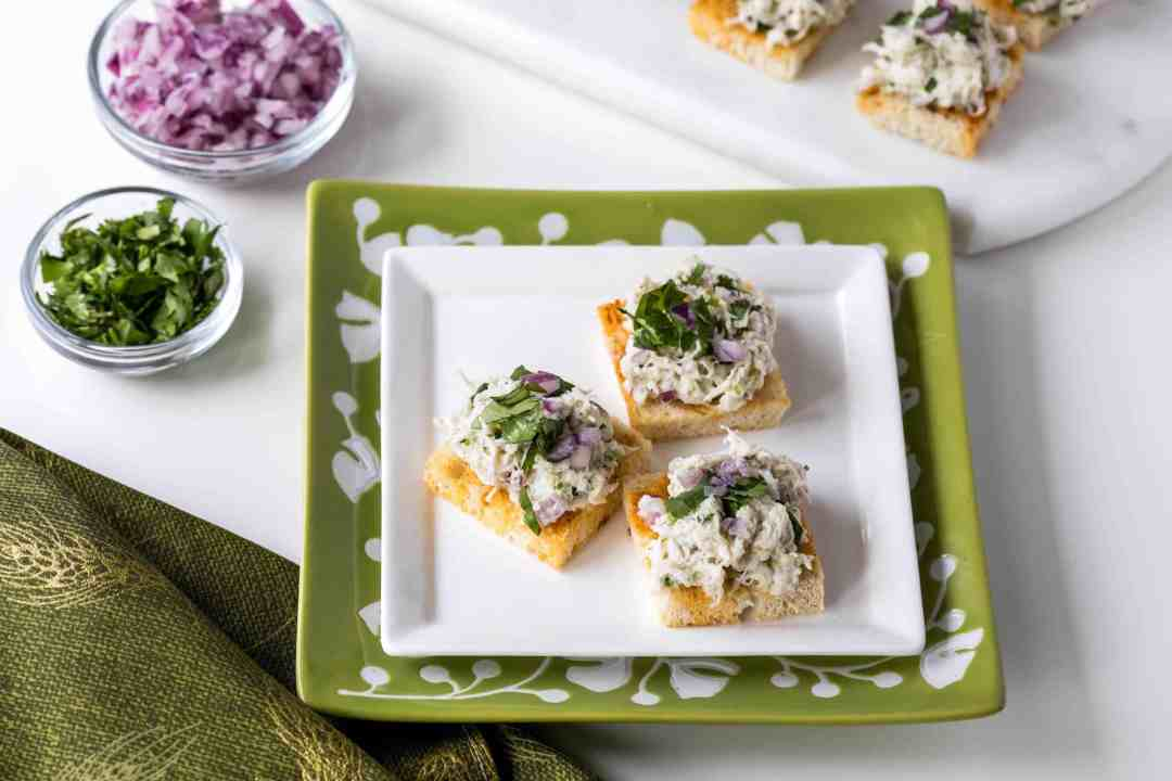 appetizer plate of crab salad on paprika toasts