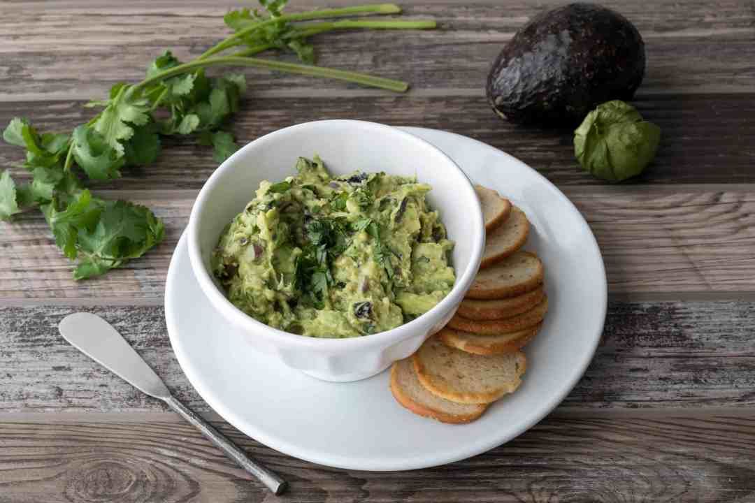 charred tomatillo guacamole with bagel chips