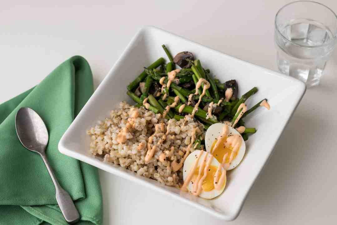 parmesan pearl barley grain bowl with asparagus and eggs