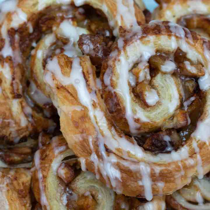 close up of puff pastry cinnamon rolls with apple