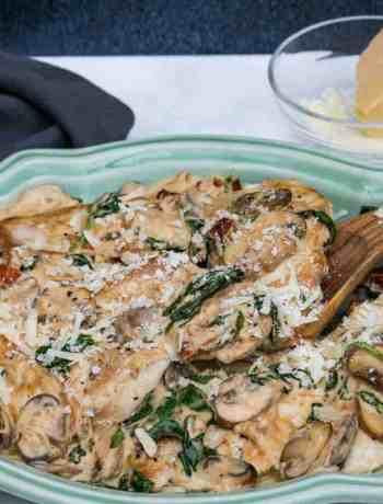 platter of creamy parmesan garlic mushroom chicken with spoon