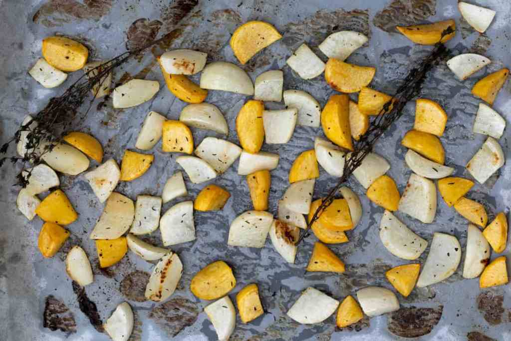 Roasted turnips on sheet pan with thyme sprigs