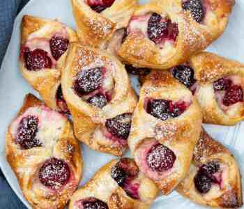plate of cherry danishes with puff pastry
