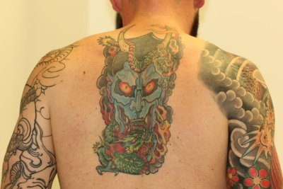 Coloured Back Tattoo Fade Before Laser