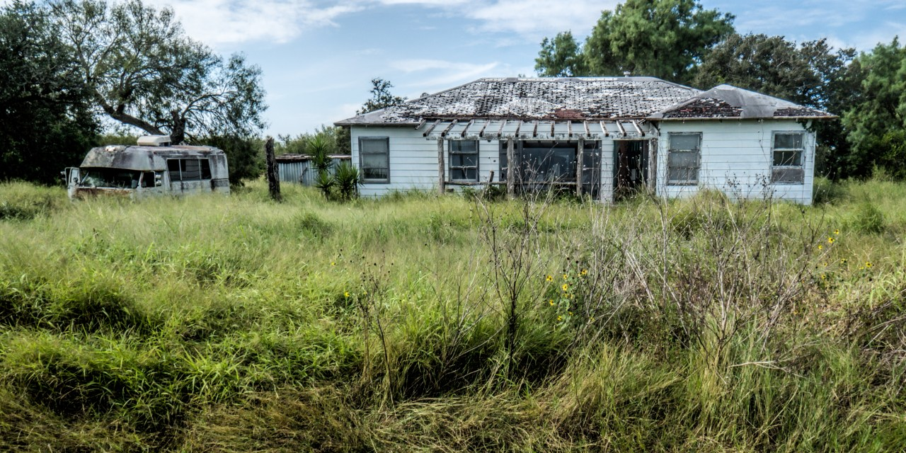 Two abandoned Farm Houses and Old Ford Econoline Motor Home Near West Sinton, Texas