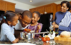 Black family in the kitchen back in June 2013 [Press Photo]