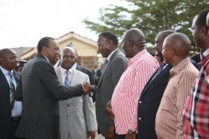 President Uhuru Kenyatta greeting Ret. Gen Nkaiserry